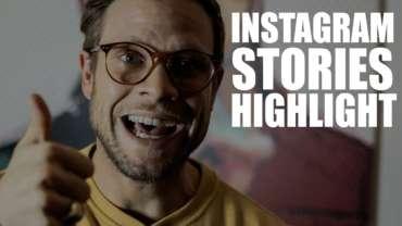 Mann mit Brille und gelben Pullover blickt in die Kamera und freut sich.